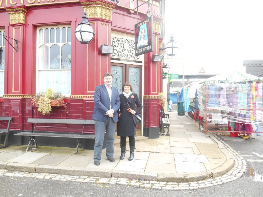 Photograph on Professor Ian Jones and Claire Dolman on the set of Eastenders outside the Queen Vic' pub