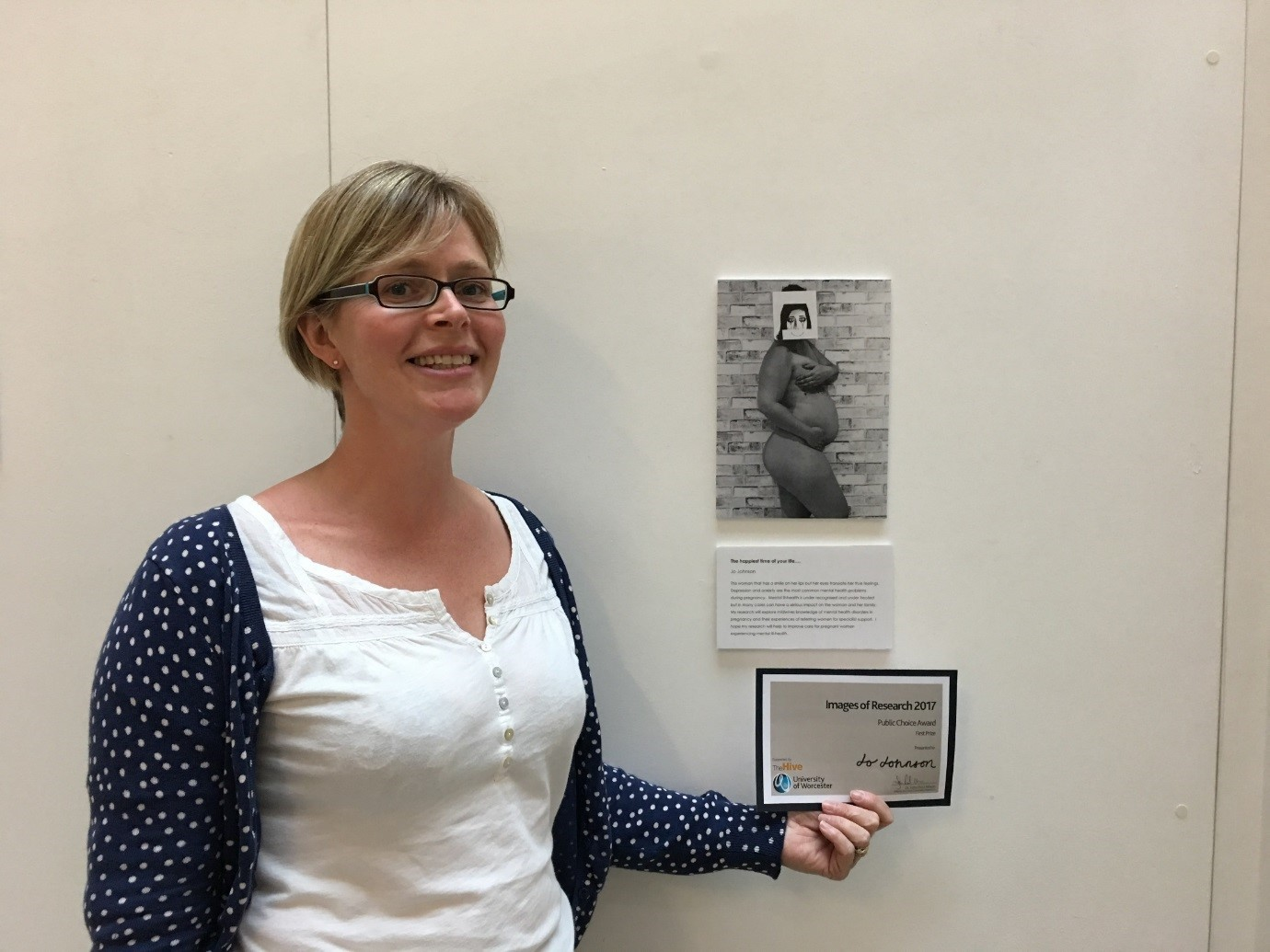 PhD student, Jo Johnson, with her entry on display at the University of Worcester Images of Research exhibition.
